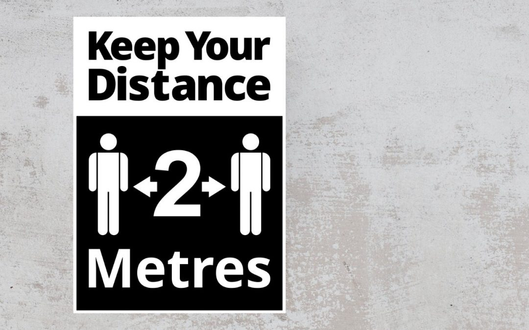 Keep Your Distance sign on wall - 2 metres - black and white