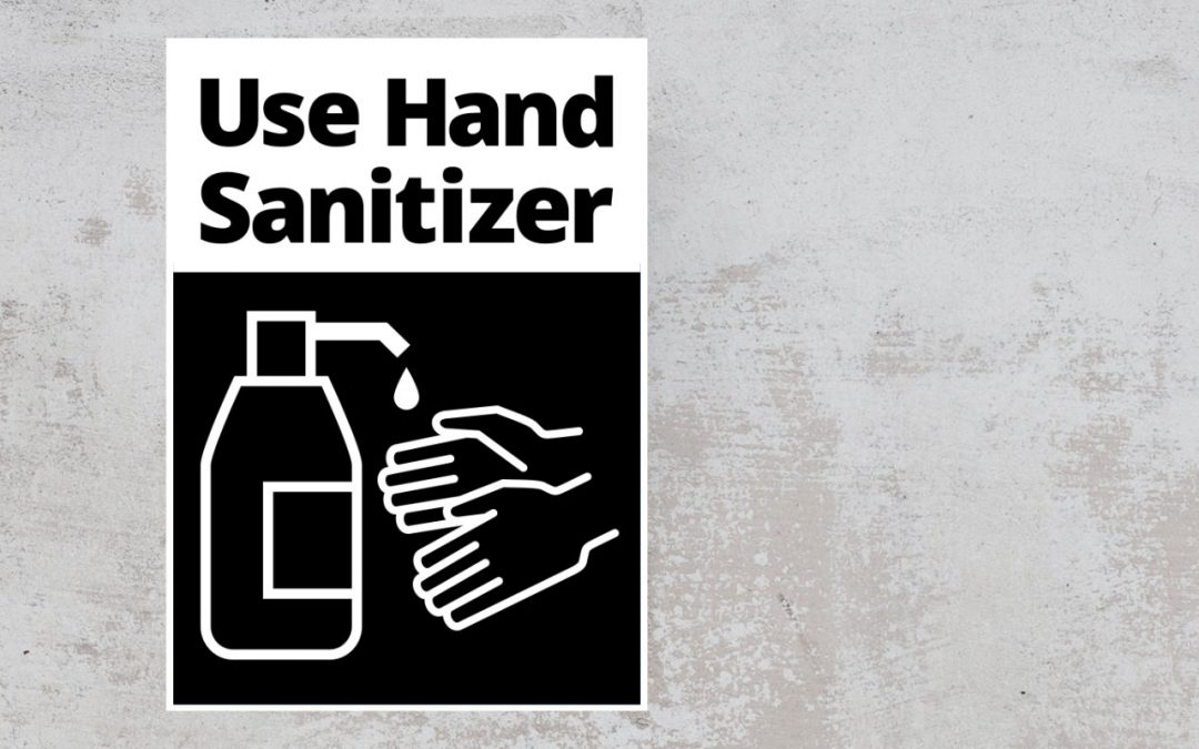 Use Hand Sanitizer sign on the wall. sign color balck and white